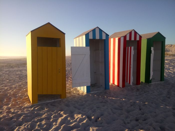 Evening Light Evening Sun Changing Room Fitting Room Colourful Sand Beach Summer Built Structure Door Architecture Wood - Material Travel Destinations No People Sunlight Vacations Multi Colored