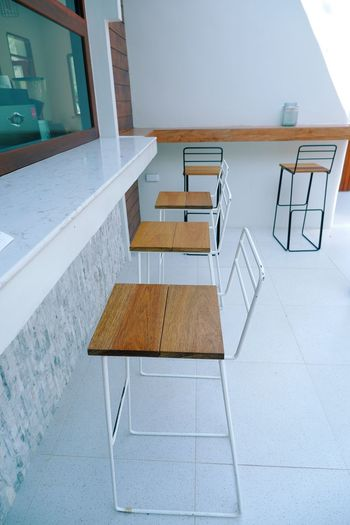 High angle view of empty chairs at table