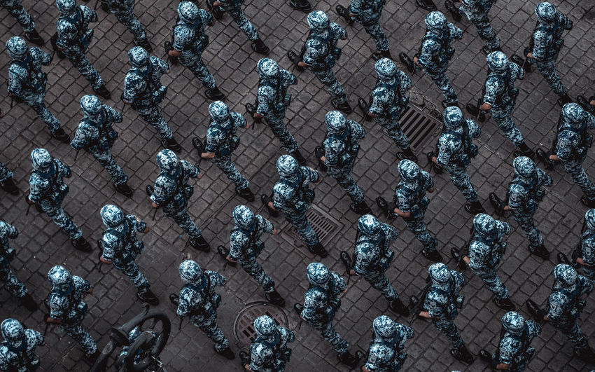 High angle view of soldiers walking on street