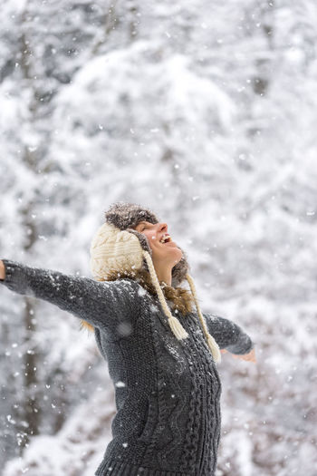 Close-up of woman on snow covered land