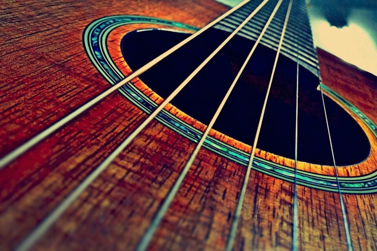 music, musical instrument string, musical instrument, guitar, musical equipment, arts culture and entertainment, acoustic guitar, woodwind instrument, indoors, wood - material, fretboard, string instrument, no people, close-up, day