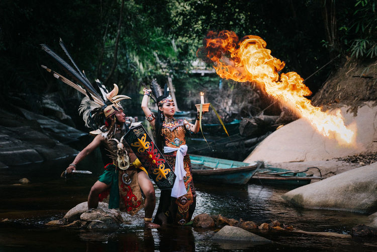 Dayak Tribe Central Kalimantan Indonesia People Motion Water Nature Real People Fire Women Flame Outdoors Burning Beautiful Woman Clothing Front View Lifestyles Dayak Young Adult Full Length Dayak Costume Young Women Dayak Culture Nautical Vessel EyeEm Best Shots EyeEm Selects EyeEm Gallery EyeEmNewHere