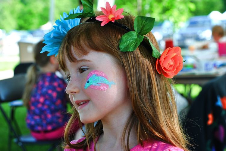 Close-up of cute girl with face paint looking away