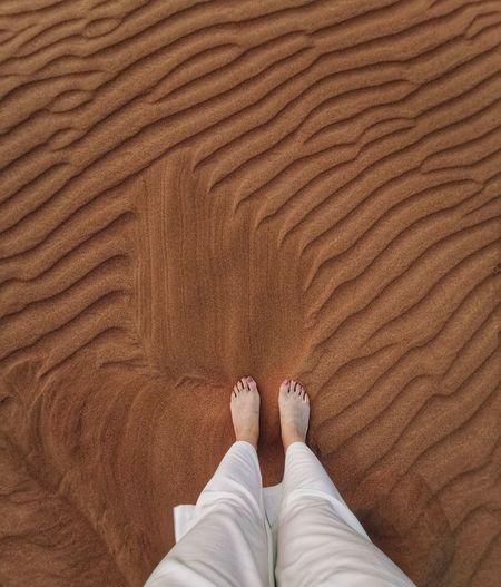 Feet in desert sand