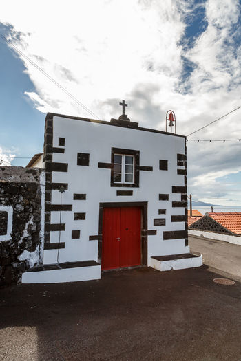 Azores Chapel Pico Island Architecture Basaltic Rock Building Building Exterior Built Structure City Cloud - Sky Day House Low Angle View Nature No People Outdoors Religious Architecture Residential District Road Sky Snow Street Sunlight Window