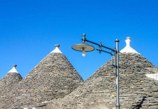 Roof of trulli and blue sky, traditional old houses in Puglia, Italy Alberobello Ancient Holiday Puglia Roof Traditional Clothing Travel Wonderful Architecture Blue Sky Building Exterior Built Structure Conical Italy No People Old Old Houses Sky Stone Traditional Trulli Trulli Houses Unesco Valle D'itria White