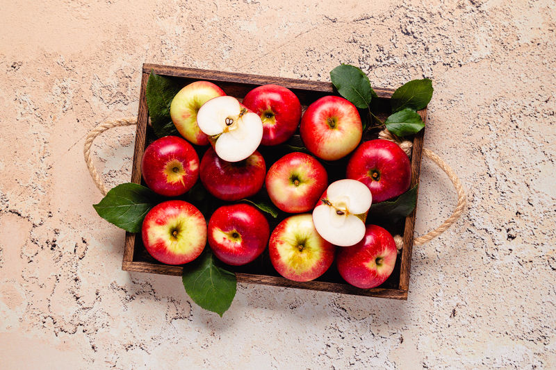 High angle view of apples in box on table