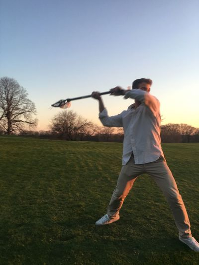 Blue Casual Clothing Day Enjoyment Field Full Length Fun Grass Grassy Green Color Lacrosse Landscape Leisure Activity Lifestyles Nature Outdoors Running Sky Sunlight Throwback
