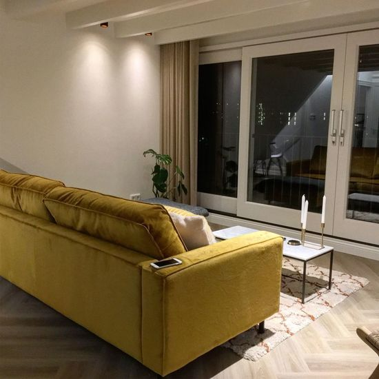 Furniture Indoors  Sofa Home Interior Architecture Built Structure Domestic Room No People Building Living Room Flooring Stuffed Illuminated House Nature Wall - Building Feature Chair Seat Home Table