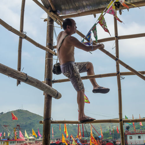 big fan Climbing Day Dragon Boat Festival Dragonboat Full Length Lifestyles One Person Outdoors Real People Shirtless Tai O Tai O Village