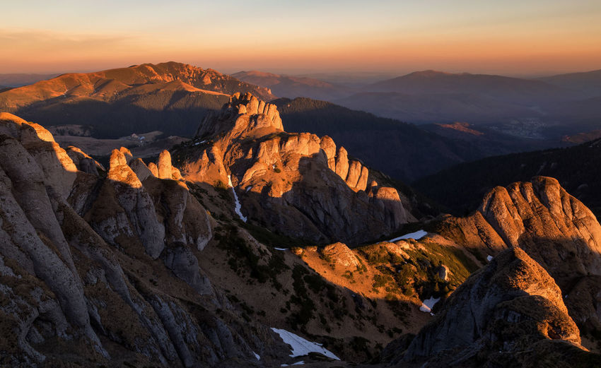 Scenic view of mountains against sky during sunset in ciucas mountains