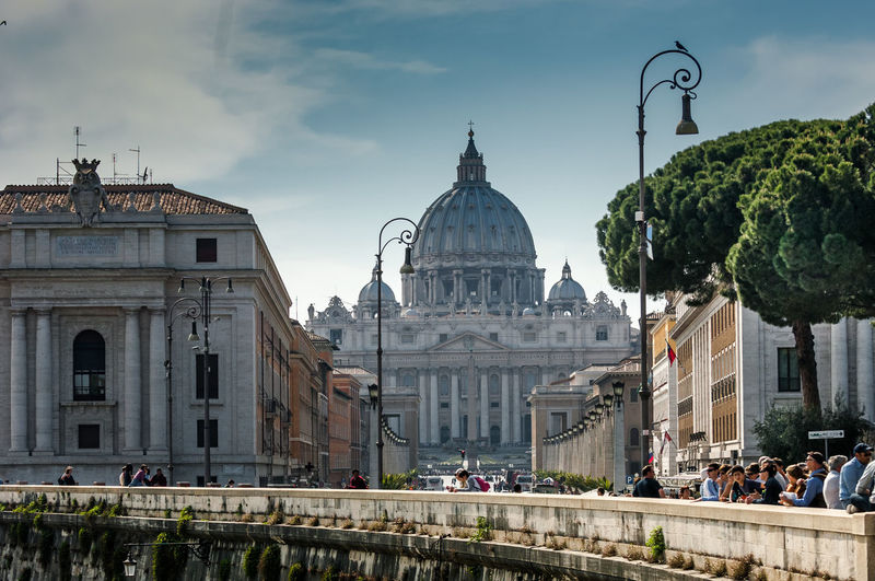 People by retaining wall against st peters basilica