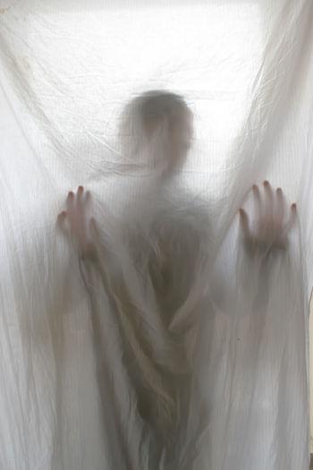 Defocused image of woman lying on bed