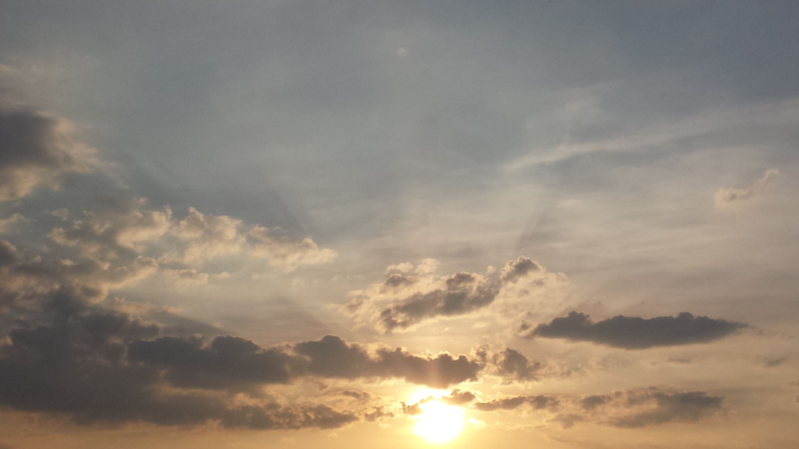sky, sunset, cloud - sky, beauty in nature, idyllic, nature, scenics, tranquility, awe, no people, tranquil scene, sun, outdoors, heaven, backgrounds, day