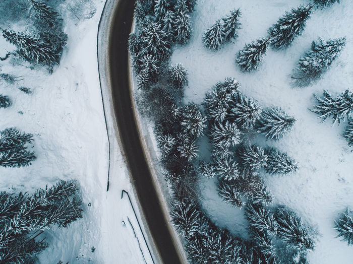 Snow Winter Cold Temperature Frozen No People Nature Tree Plant Day White Color Beauty In Nature Scenics - Nature Land Ice Covering Transportation Tranquility High Angle View Outdoors Extreme Weather Snowcapped Mountain Coniferous Tree Blizzard