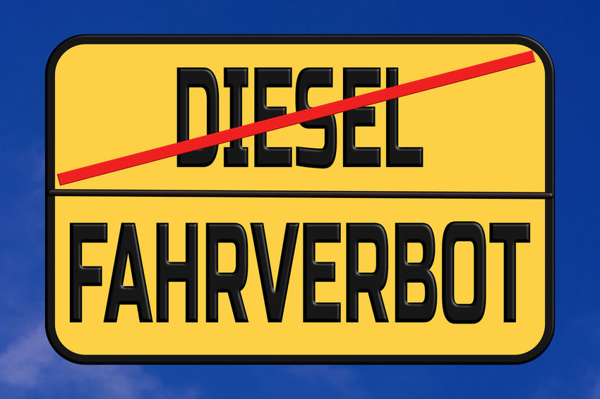 Driving traffic signs for diesel cars in Germany. Diesel Interdiction symbol Communication Sign Text Western Script Yellow Capital Letter No People Information Warning Sign Information Sign Blue Close-up Guidance Day Red Direction Black Color Outdoors Road Sign Bright Message