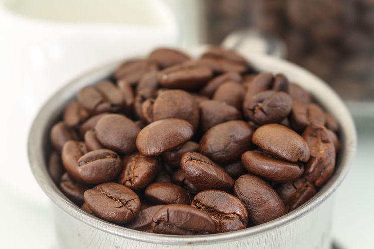 Close-Up Of Roasted Coffee Beans Brown Cafe Caffeine Coffee Coffee Beans Coffee Collection Cup Enjoying Life Eye4photography  EyeEm Best Shots EyeEm Gallery Food And Drink Freshness Grain Healthy Food Relaxing Roasted Still Life Taking Photos Taste Textures And Surfaces