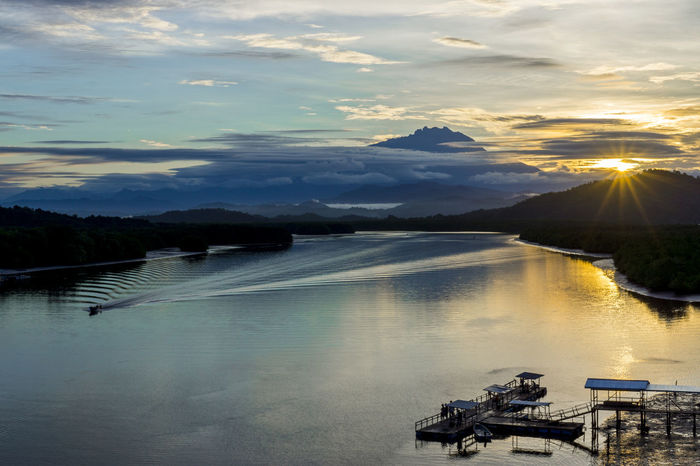 Borneo Mount Kinabalu Pier Beauty In Nature Cloud - Sky Day Fishing Mengkabong River Mountain Nature Nautical Vessel Outdoors Reflection River Sabah Scenics Sky Sunrise Tranquility Tree Water