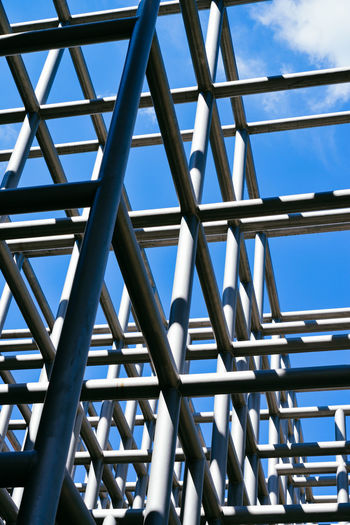 Architectural Still Life - Cubic Bars Under Blue Sky Architectural Feature Architecture Bars Blue Sky Cube Cubes Cubic Geometric Shape Geometry Intertwine Low Angle View No People Outdoors Shapes Squares Structure