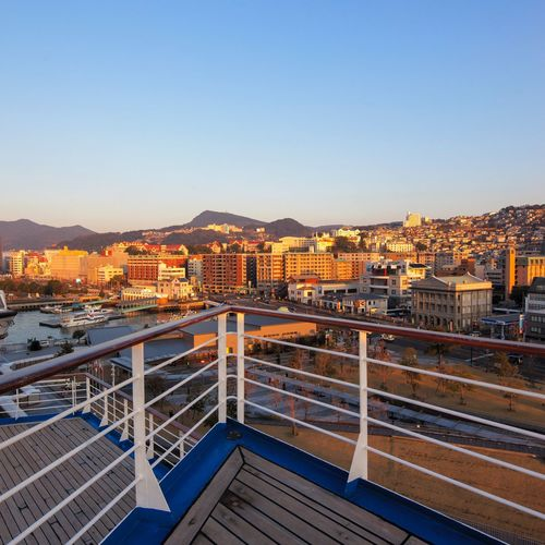 Nagasaki, Japan in the setting sun Cruise Ship Sunset Lovers City View  City View  Japan Photography Travel In Japan Nagasaki, Japan Architecture Built Structure Sky Building Exterior City Clear Sky Cityscape Nature Outdoors No People