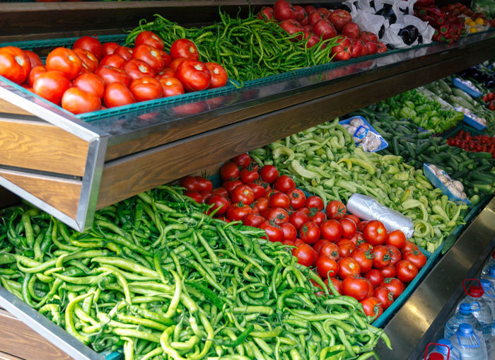 Food Food And Drink Freshness Green Green Color Green Hot Peppers Green Peppers Healthy Eating Market Market Stall Nature No People Outdoors Peppers Peppers And Onions Retail  Tomato Tomatoes Vegetable Shop Shopping Time