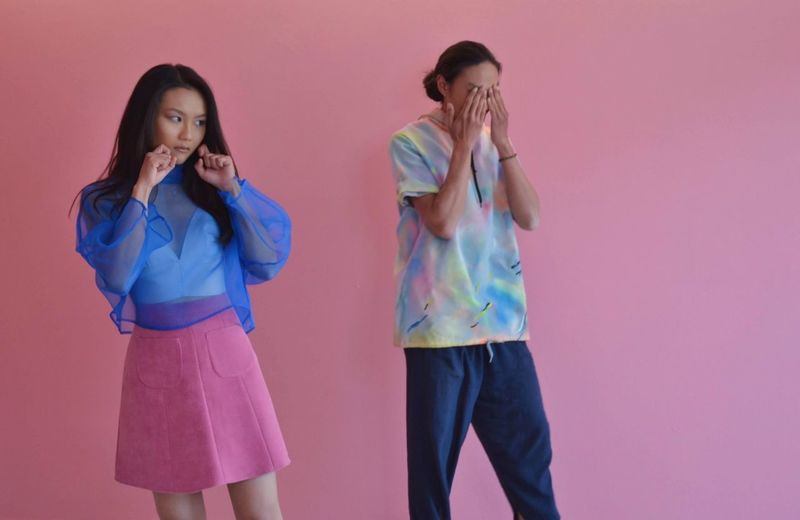 People posing against pink background