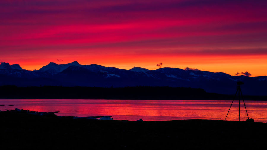 Beauty In Nature Day Idyllic Lake Landscape Mountain Mountain Range Nature No People Orange Color Outdoors Scenics Silhouette Sky Sunset Tranquil Scene Tranquility Water