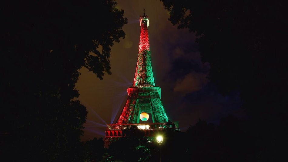 The Eiffel Tower adorned with the colours of the winning team Portugal, Euro 2016. Football Euro 2016 Portugal Winners Paris France Travel Eiffel Tower Winners ! HUAWEI Photo Award: After Dark