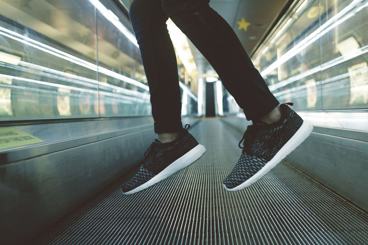 Air Boy Escalator Freeze Jump Jumping Lifestyles Modern Shoes Unrecognizable Person