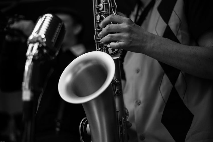 Midsection Of Man Playing Saxophone During Concert