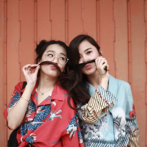 pastel 50 Ways Of Seeing: Gratitude Friendship Young Women Portrait Togetherness Bonding Looking At Camera Red Headshot Standing Protruding Red Lipstick Lipstick Make-up Twin Arm In Arm Human Lips Self Portrait Photography