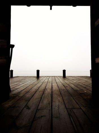 sitting on the dock of the bay Leading Lines Lines Platform Archipelago Dock Serene Fog Foggy Hazy  Haze Wood - Material Nautical Empty Copy Space Public Transportation Wooden