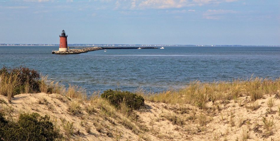 Cape Henlopen Delaware Bay Architecture Beauty In Nature Built Structure Day Grass Horizon Over Water Lighthouse Nature Nautical Vessel No People Outdoors Scenics Sea Sky Tranquil Scene Tranquility Water