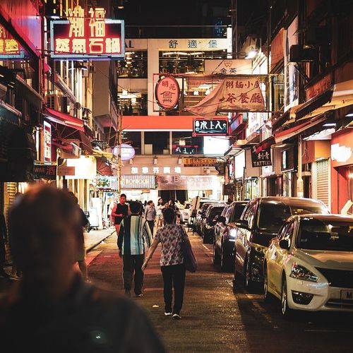 Night in Hong Kong Illuminated City Store Men Consumerism Customer  Retail  Women City Street Rear View Street Scene Pedestrian Commercial Sign Zebra Crossing Store Sign Crossroad Vehicle Information Road Signal Advertisement EyeEmNewHere