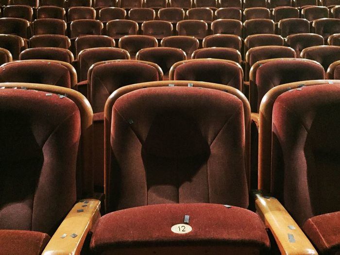 Full Frame Shot Of Empty Seats At Movie Theatre