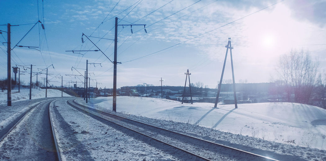 Architecture Building Exterior Built Structure Cable City Cold Temperature Day Electricity Pylon Extreme Weather Industry Nature No People Outdoors Power Line  Rail Transportation Railroad Track Sky Snapseed Snow Sun Transportation VSCO Vscocam Vscogood Winter EyeEmNewHere