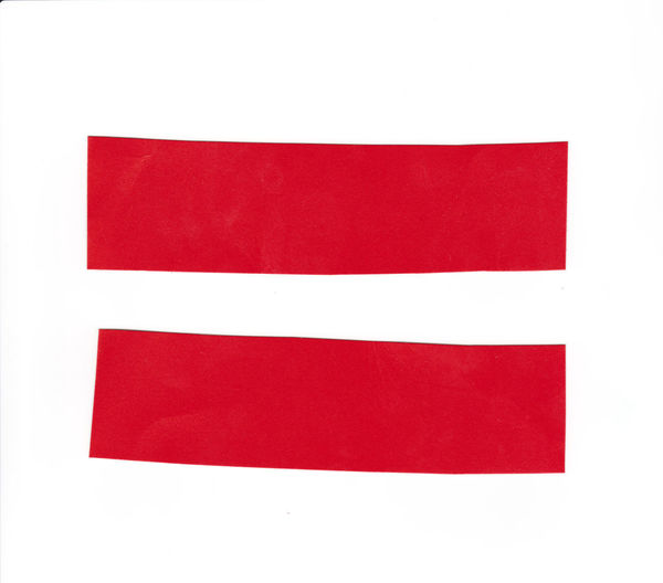 Close-up of red flag against white background