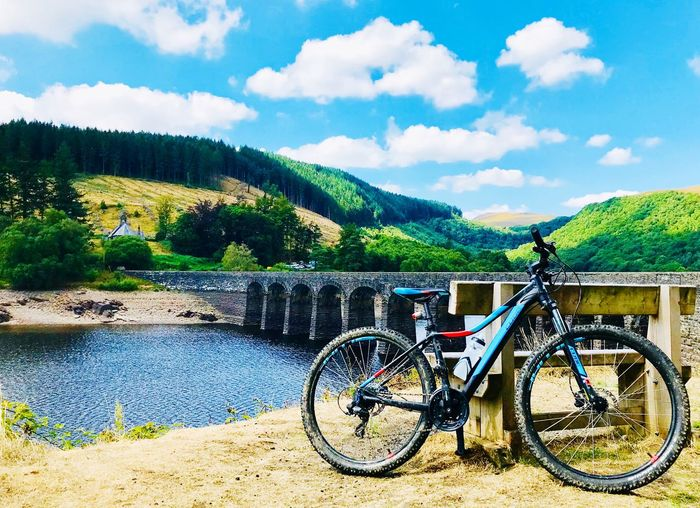 Elan Valley Cubebikes Sky Cloud - Sky Transportation Day Nature Bicycle Plant Mountain No People Tree Tranquility Beauty In Nature Outdoors Water Scenics - Nature Tranquil Scene