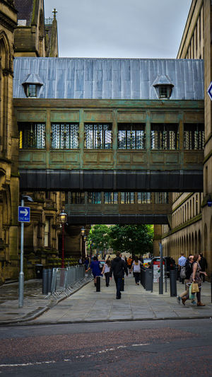 building bridges EyeEmNewHere Adult Adults Only Architecture Building Exterior Built Structure City Day Large Group Of People Men Outdoors People Real People Sky