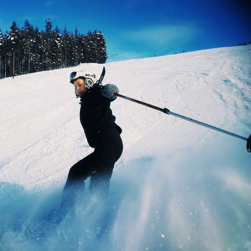 Man skiing in snow against sky