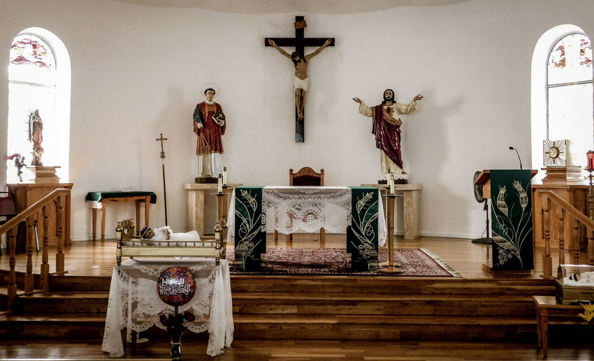 San Lorenzo, Catholic Church, Clint Texas. Saint Lorenzo is the Patron Saint of Cooks Religion Belief Spirituality Place Of Worship Indoors  Cross Art And Craft Sculpture Altar Architecture Human Representation No People Statue Male Likeness Building Wood - Material Antique