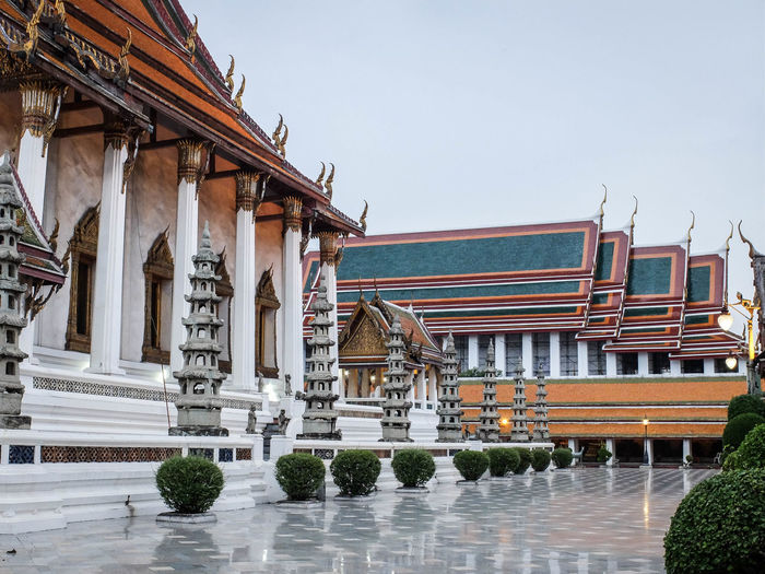 Architecture Buddhism Building Exterior Built Structure Clear Sky Place Of Worship Reflection Temple