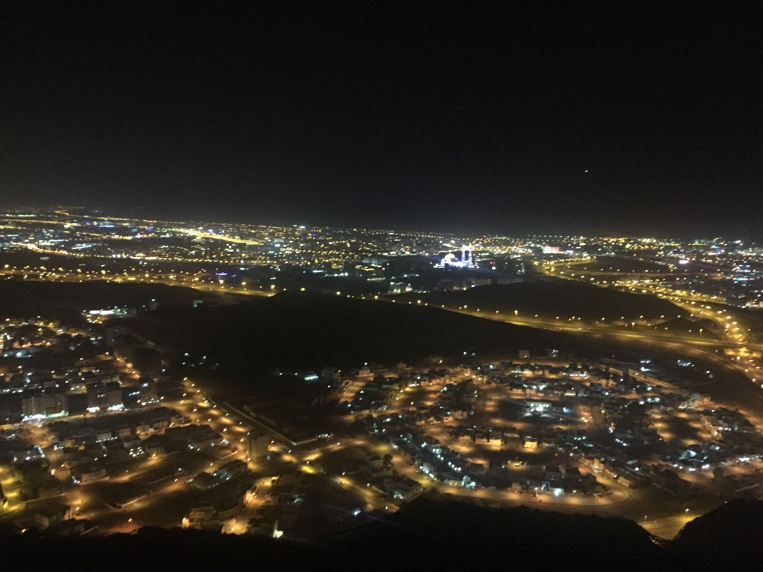 cityscape, night, illuminated, city, aerial view, building exterior, no people, outdoors, travel destinations, sky, architecture, water, urban skyline