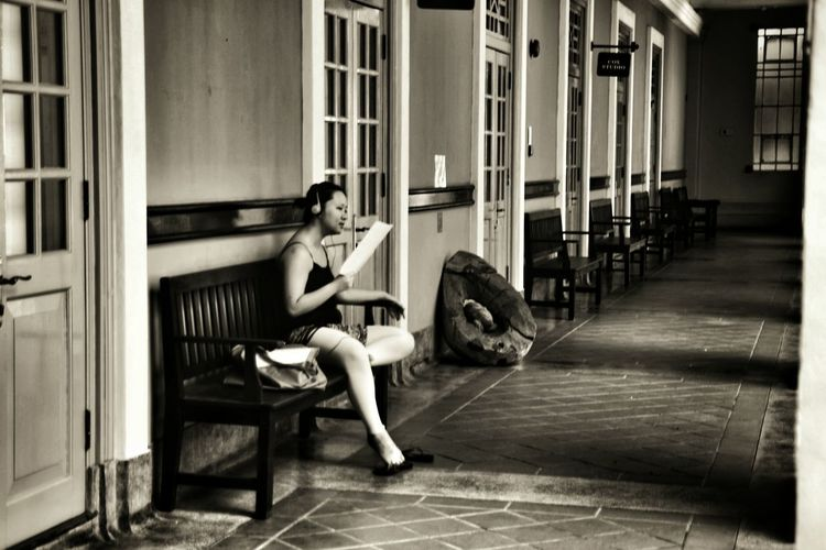 Girl and paper Girl Corridor Performing Performing Arts Performer  Practicing Script Notes Sitting Old Buildings Wooden Bench