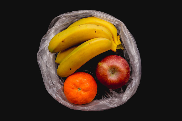 Banana, orange and apple in open plastic bag Bag Plastic Plastic Bag Food Fruit Fruits Organic Organic Food Vegetable Vegetables Closed Wrapped Plant Protection Red Store Supermarket Transparent Vitamin Juicy Juicy Fruit Nature Ripe Ripe Fruit Arrangement Bright Black Background Freshness Fresh Ingredient Ingredients Healthy Eating Healthy Food Cut Out Environmental Conservation Environmental Damage Buy Buying Inside Natural Condition Raw Food Diet Dieting Ready-to-eat No People Banana Apple Orange Wellbeing Still Life