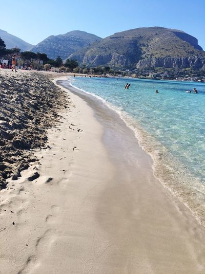 Wonderful Beach ~ Palermo, Sizilia Beach Sand Water Mountain Sea Nature Day Beauty In Nature Outdoors Real People Scenics Sky Vacations People In The Background Large Group Of People People Italy