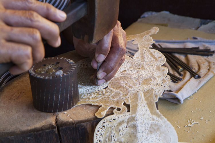Close-up of woman doing craft on table