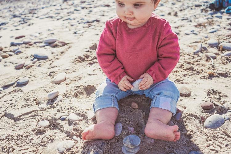 Full length of boy on sand at beach
