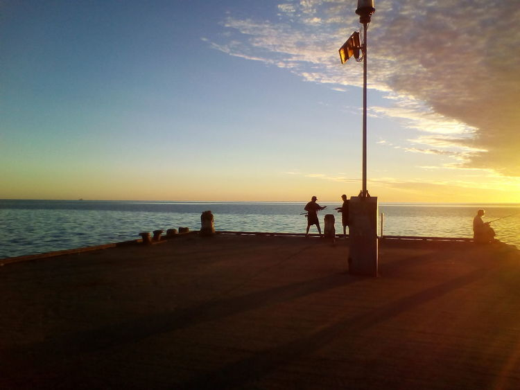 Fishing on the Edithburg jetty at sunrise Sea Horizon Over Water Outdoors Sky Beauty In Nature Sunset Water Sea And Sky Jetty View Eyeemnew Fishing Rod People Fishing Cloud And Sky Jetty Ocean Sky Jetty Colour Of Sky