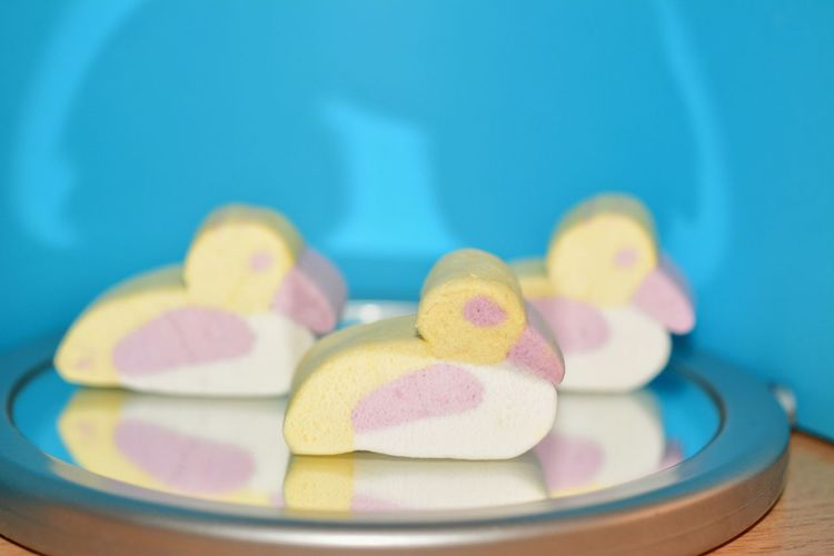 Close-Up Of Bird Shape Marshmallows Served On Table